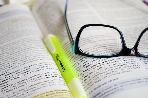 eye glasses on open book