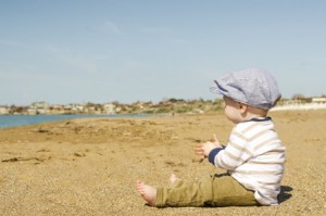 toddler sitting at beach