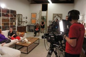 On the Telling Stories set with host Jules Carlysle